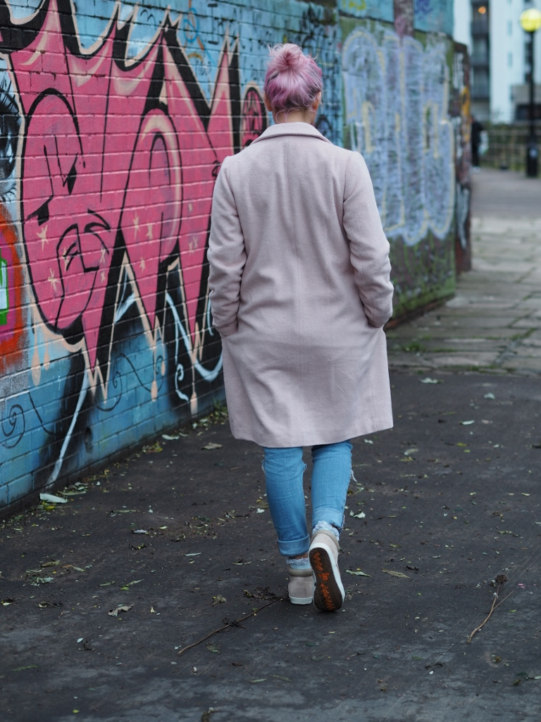 pastel pink coat and pastel pink hair