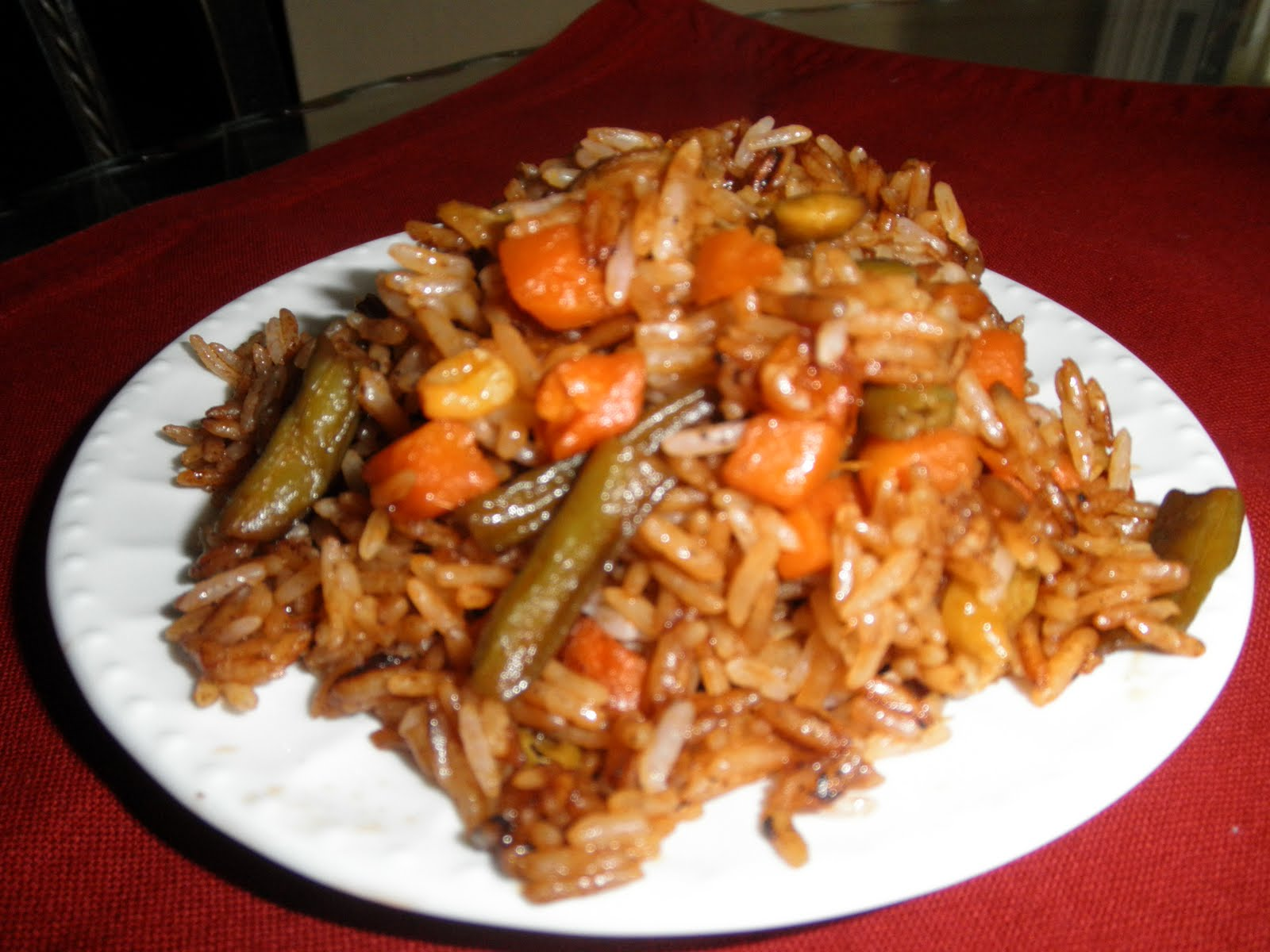 Haitian Creole Preparing Rice With Mixed Vegetables And