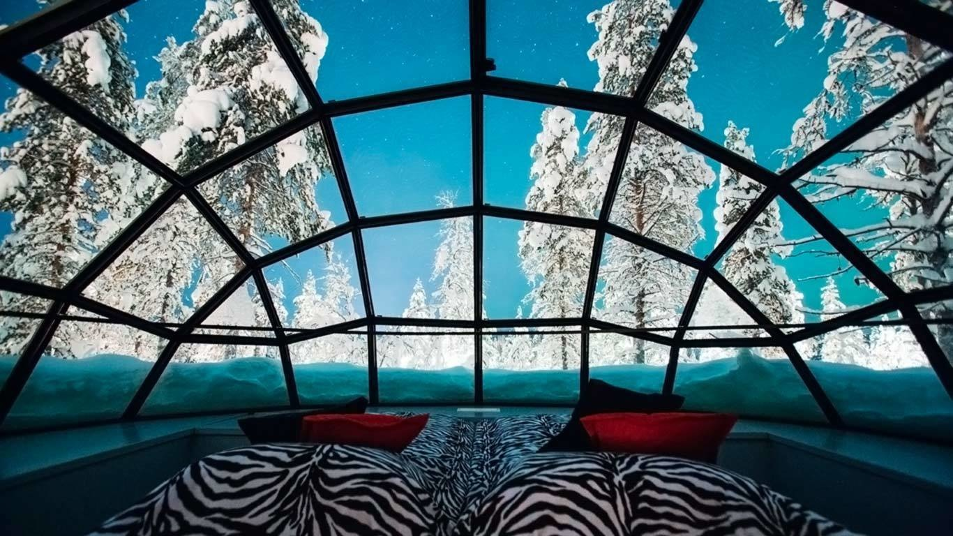 Kakslauttanen, Saariselkä, Finland - 15 Incredible Hotel Rooms Where You Can Sleep Under The Stars.