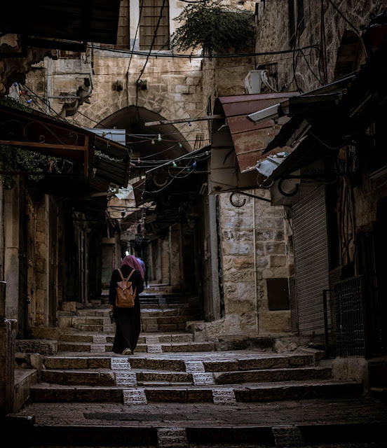 A Muslim girl walking in the streets of the Old City