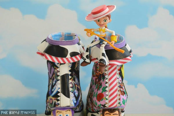 small Toy Story Jessie figure sitting on top of cuff of ankle boots