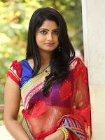 Mounica in saree at Tolikiranam movie event-cover-photo