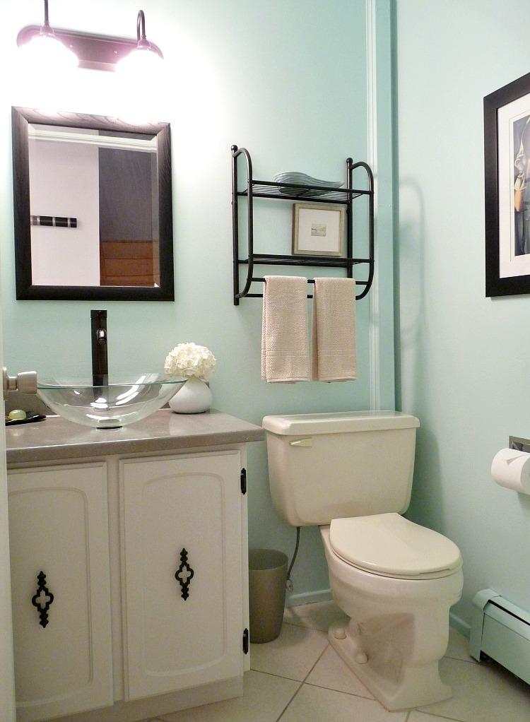 Aqua bathroom; glass vessel sink + black faucet