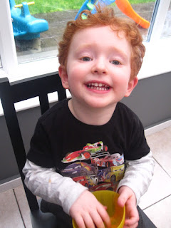 Red haired boy enjoying snacks