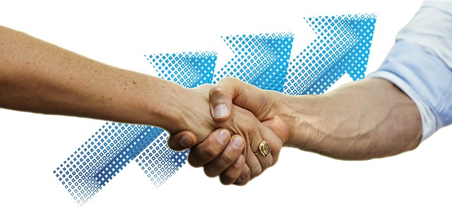 Business handshake between a woman and a man