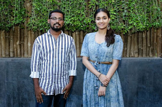 Keerthy Suresh in Blue Dress with Cute and Lovely Smile with a Fan