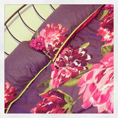 Freshly made bed - new purple floral bedding