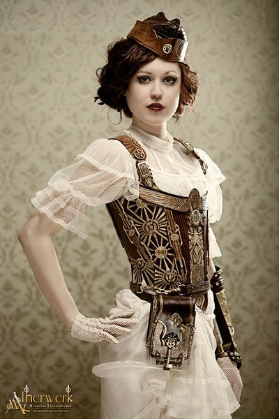 Women's steampunk clothing with white lace victorian dress, paired with ornate leather corset, hat, utility belt and bracer.