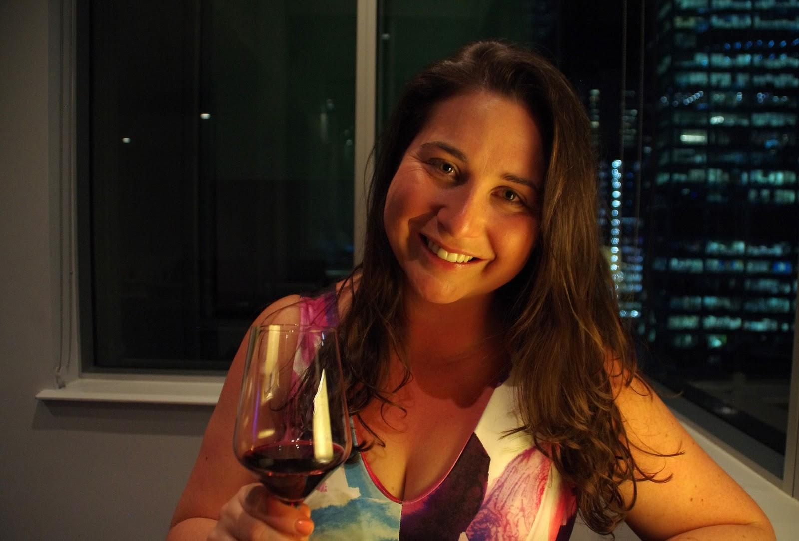 Simone having a glass of wine in Swissotel Executive lounge Sydney