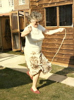 Older lady skipping in her garden