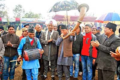 Bimal Gurung plays a traditional instrument at Meghatar near Darjeeling
