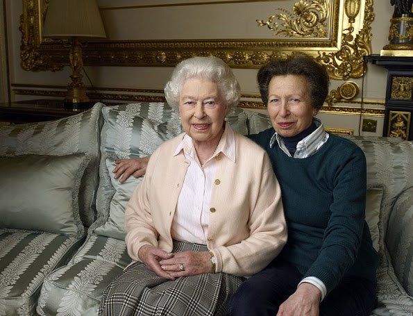 The second portrait is a rare and surprisingly warm shot of the Queen with her daughter Princess Anne in the Palace's White Drawing Room