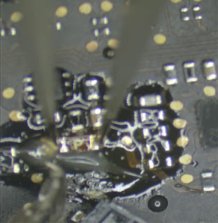 use tweezer to move component form phone circuit is easy