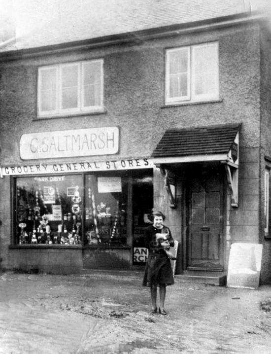 Photograph of Saltmarsh Stores, 5 Sibthorpe Road, 1936. Daughter Rhoda with her cat. Now a private house