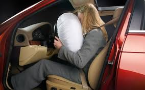 Women with car airbag Joke