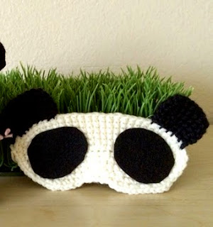 http://www.yarntreasures.com/free-panda-sleep-mask-pattern/