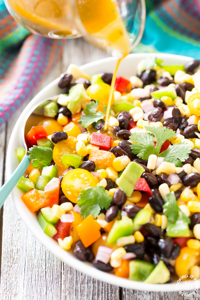 How does this easy black bean and corn salad sound?  It is loaded with fresh ingredients and drizzled with a chili lime vinaigrette.  You'll want to serve this soon and often!