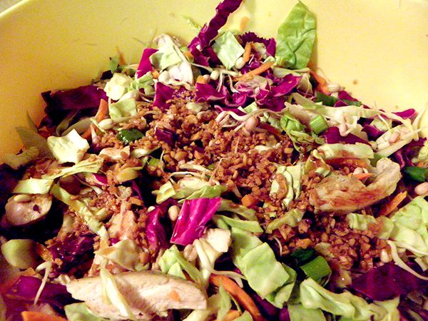 Large Bowl of Salad Topped with Ginger Dressing
