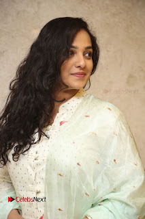 Actress Nithya Menen Latest Pictures in White Dress at 100 Days of Love Movie Audio Launch  0066.JPG