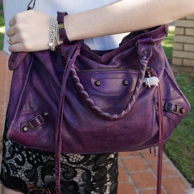 away from the blue balenciaga purple sapphire city bag worn with long strap