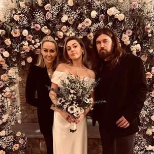 Cyrus's wedding look may very well be even more low-key than how she's worn her hair and makeup for recent public appearances and performances, which have often incorporated red lips and ponytails.