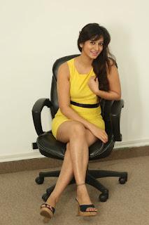 Actress Harshika Poonacha Stills in Yellow Short Dress at Appudala Ippudila Movie Promotions  0099.jpg