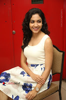 Actress Ritu Varma Stills in White Floral Short Dress at Kesava Movie Success Meet .COM 0173.JPG