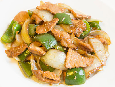 Chinese food - Onion fried with pork and green paprica