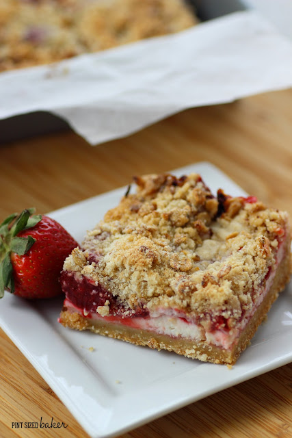 Pre-made cookie dough and strawberry pie filling makes these Strawberries and Cream Cookie Crumble Bars easy to make!