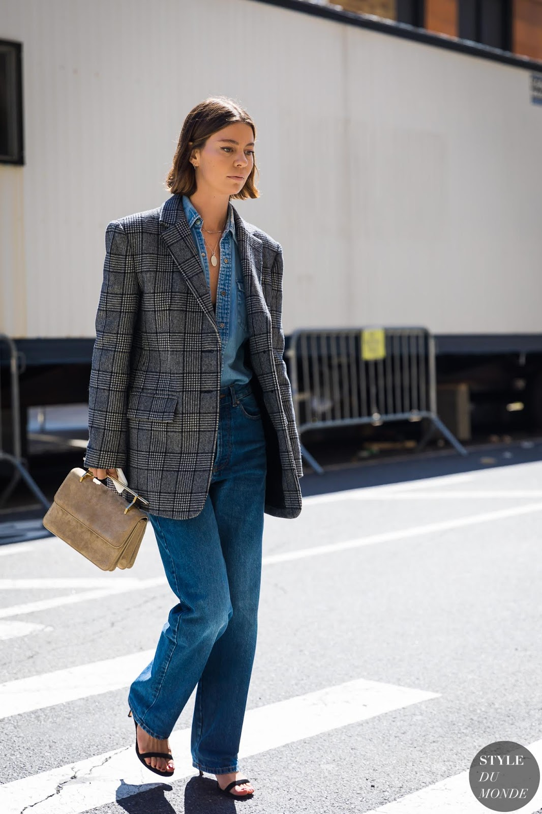 Denim-On-Denim Spring Outfit Inspiration — Annina Mislin in a plaid blazer, denim shirt, straight-leg jeans, and strappy black sandals