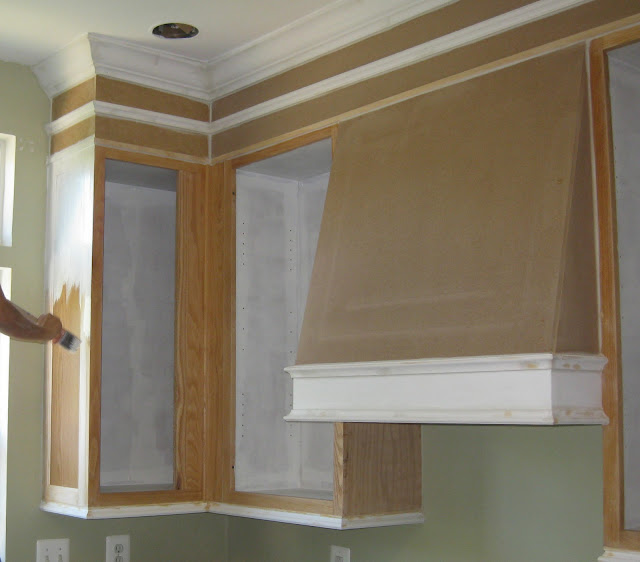 Painting a builder's grade kitchen and building a range hood.