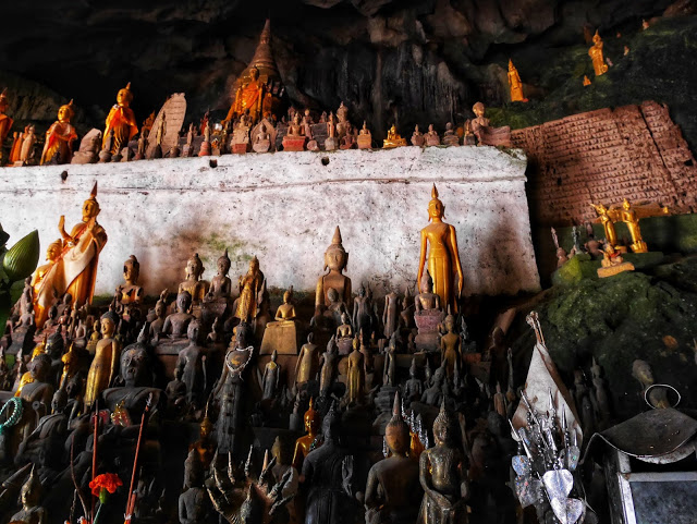 thousands of Buddha statues inside the Pak Ou Caves, Luang Prabang