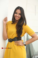Actress Poojitha Stills in Yellow Short Dress at Darshakudu Movie Teaser Launch .COM 0135.JPG