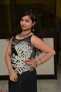 Shrisha Dasari in Sleeveless Short Black Dress At Follow Follow U Audio Launch 075.JPG