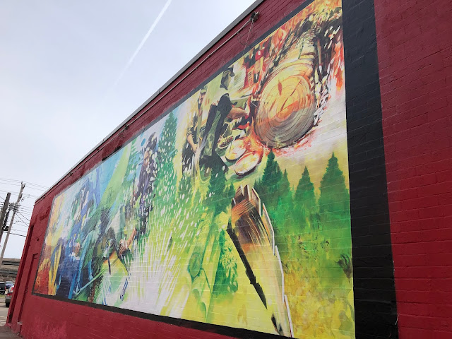 "Painted by Paul LaJeunesse this mural reflects the changing neighborhood of ""Lincoln Park"" in Duluth, Minnesota."