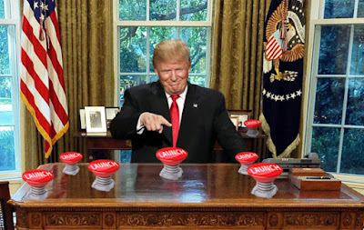 trump oval office pushes nuke launch code button