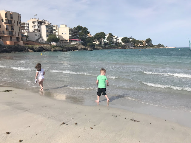 my children walking along the beach in Santa Ponsa Majorca