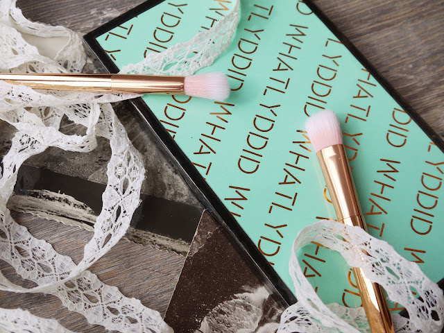 a palette wrapped in mint green paper with 'whatlyddid' in copper foil letters