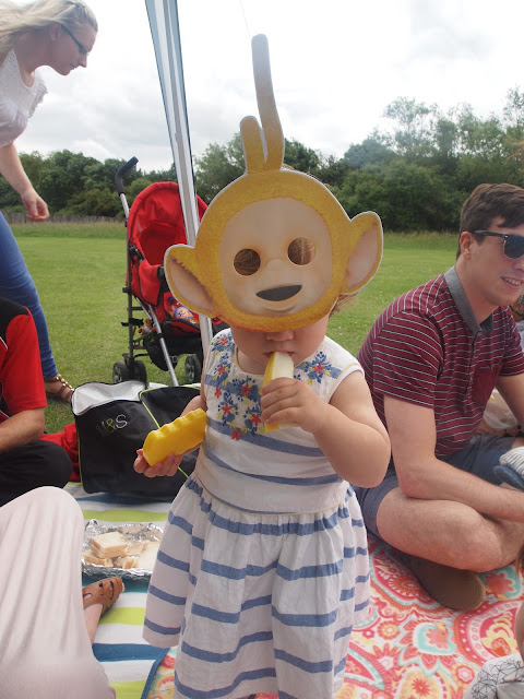 Toddler in Teletubbies mask