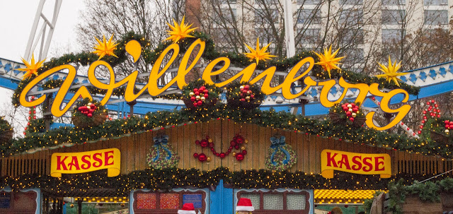 Colorful sign at the entrance to the Ferris wheel at the Christmas market in Berlin, Germany