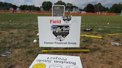 sign at one of the wiffle ball diamonds between games