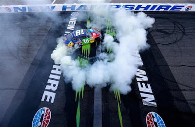 Kyle Busch, in the #18 M&M's Caramel Toyota, Celebrates  His New Hampshire Motor Speedway Win With A Burnout.