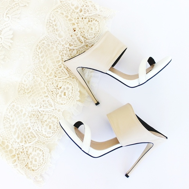 white and beige Guiseppe Zanotti mules