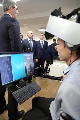 Vladimir Putin at the exhibition of projects carried out with support from the Agency for Strategic Initiatives (ASI).