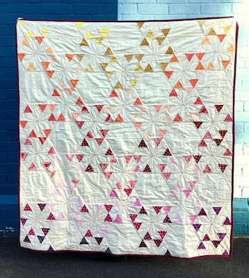 http://www.blossomheartquilts.com/2016/07/little-ruby-confetti-quilt-reveal/
