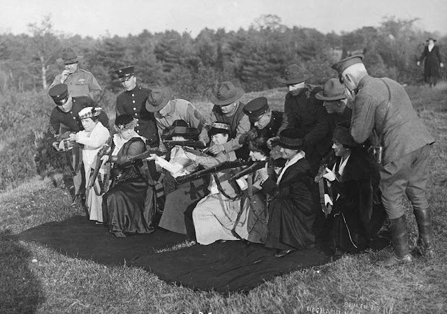 Original caption: Wives and mothers of men at the front, being instructed in shooting at the Wakefield rifle range in Wakefield, Massachusetts, by Major Portal and U.S. Marines.