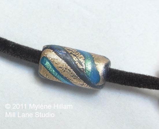 Thread the large holed bead onto the velour coated jewellery tubing