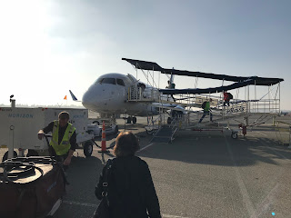 Boarding a jet plane on a sunny day