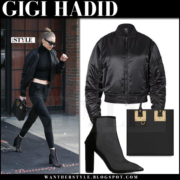 Gigi Hadid in black bomber jacket and black mesh ankle boots and hadid eyewear sunglasses what she wore