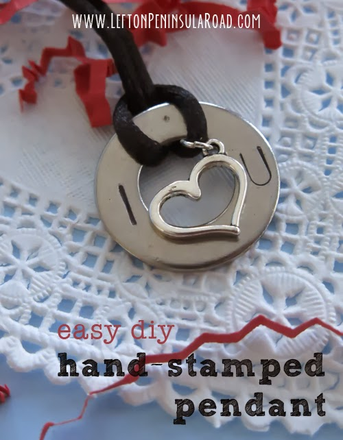 Stamped Valentine's Day Washer Pendant displayed on white lace doily.